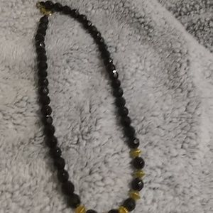 Black beaded necklace with gold accents